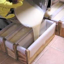 Pouring cold process soap into molds.